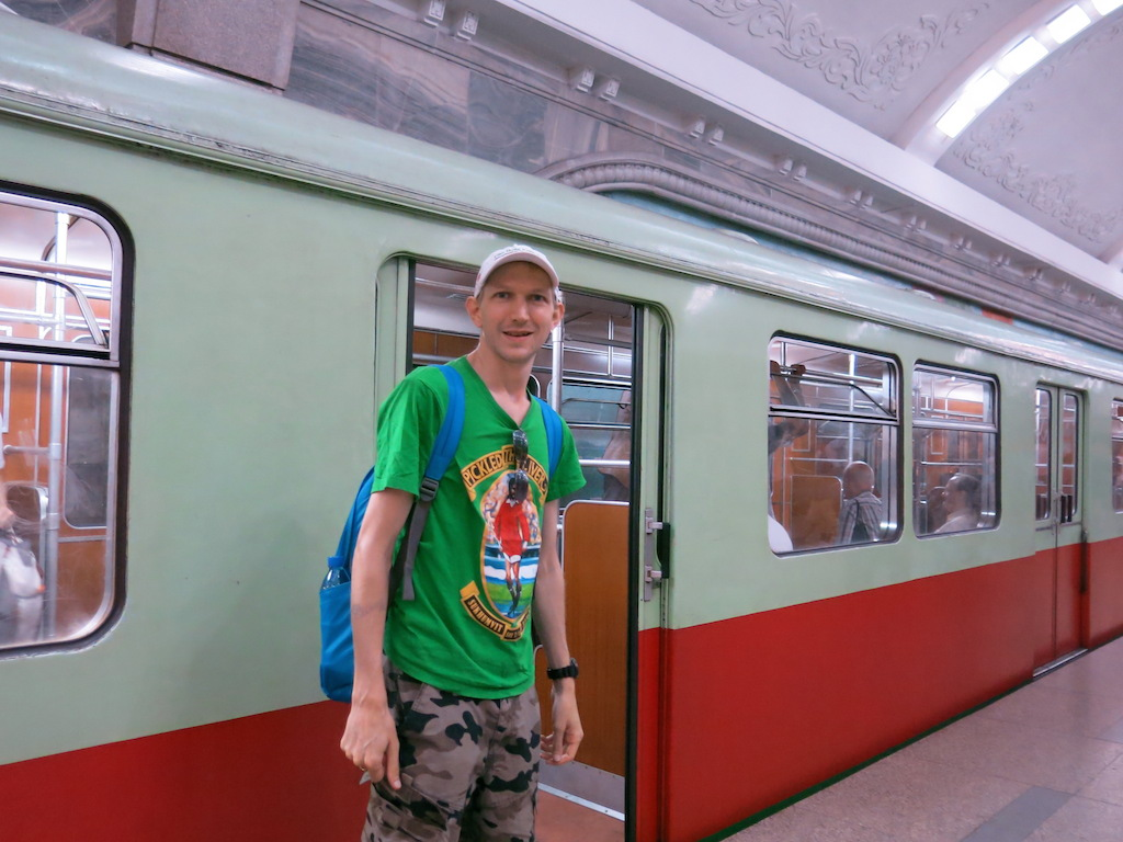 Jonny Blair using the metro system in Pyongyang North Korea