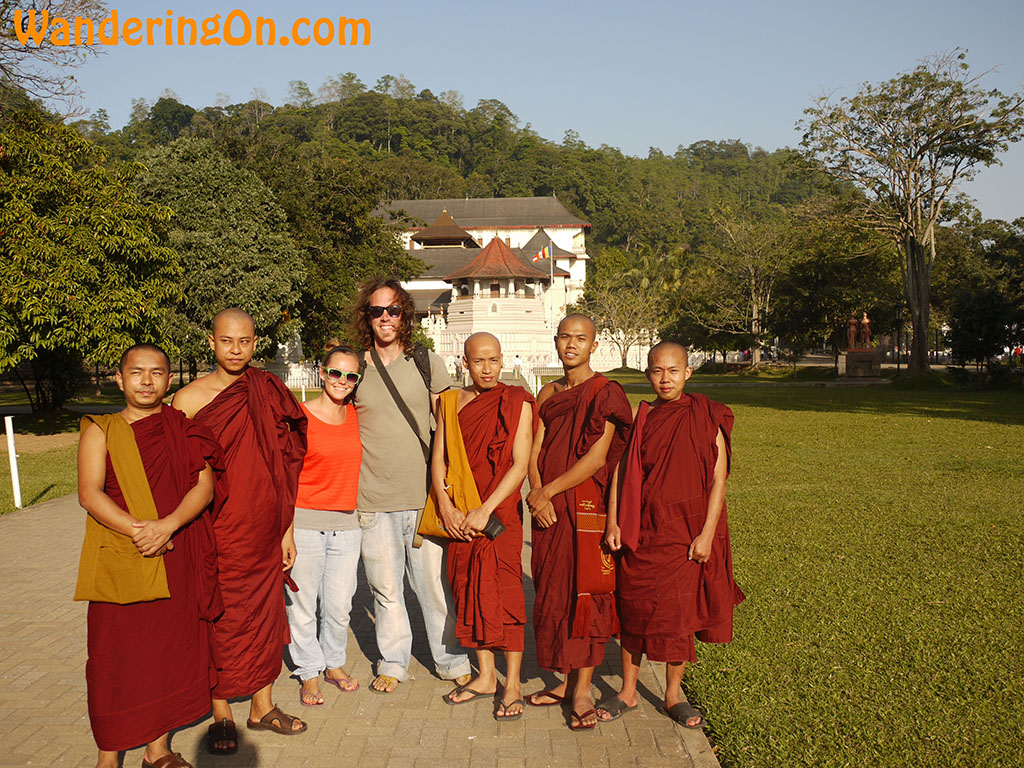 Brian and Noelle with Buddhist monks from Myanamar outside the Temple of the Tooth in Kady, Sri Lanka